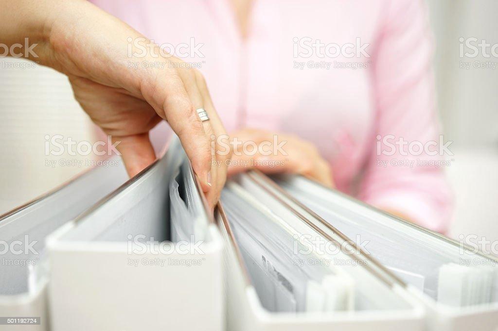 businesswoman is inspecting documentation stock photo