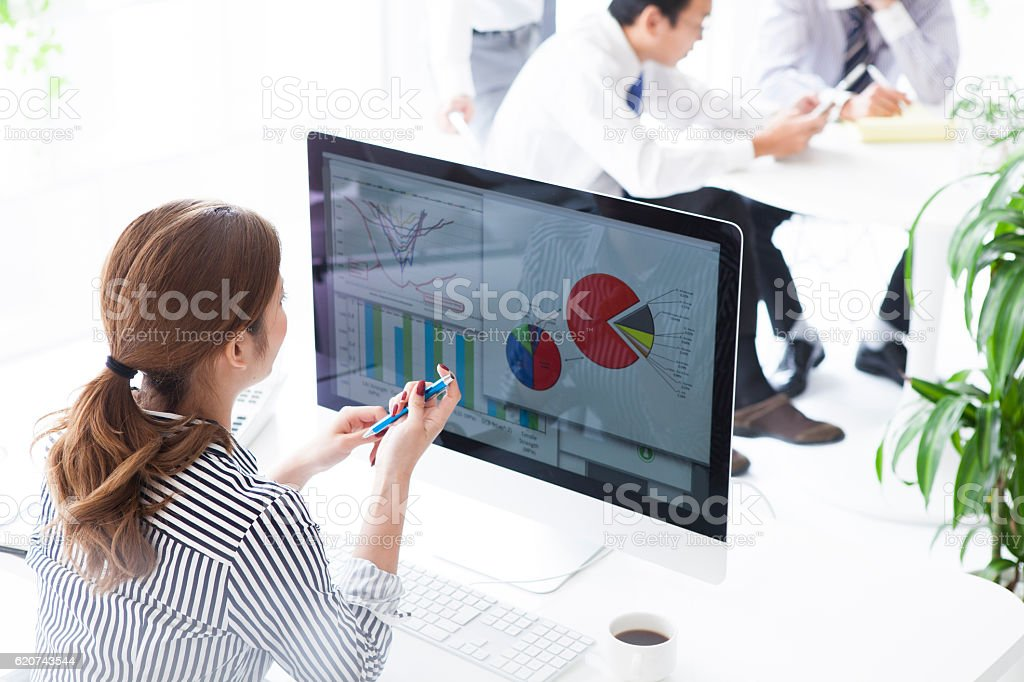 Businesswoman is making meeting materials on your computer stock photo