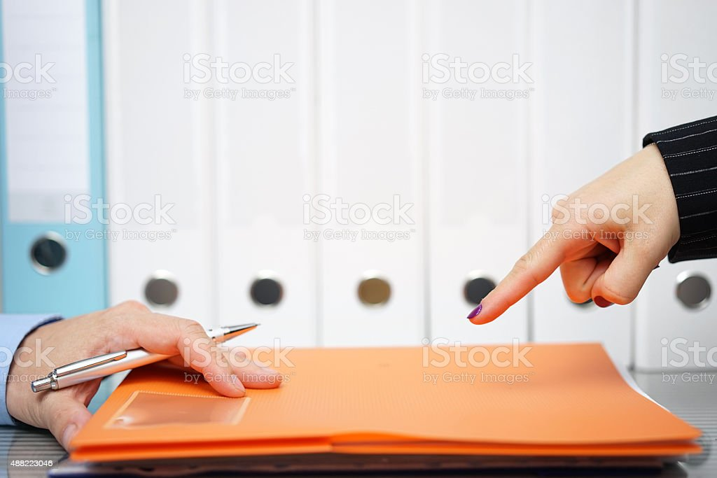 businesswoman is pointing with finger to unfinished work to be done stock photo
