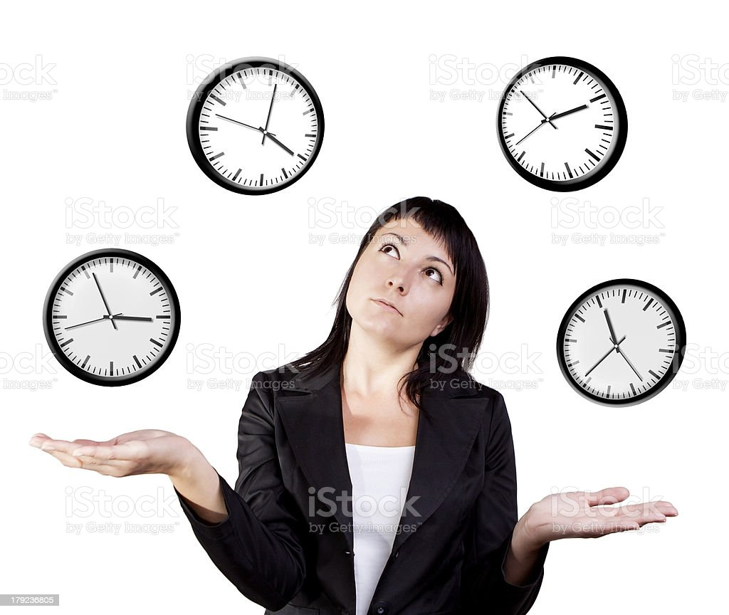 Businesswoman juggling clocks. stock photo