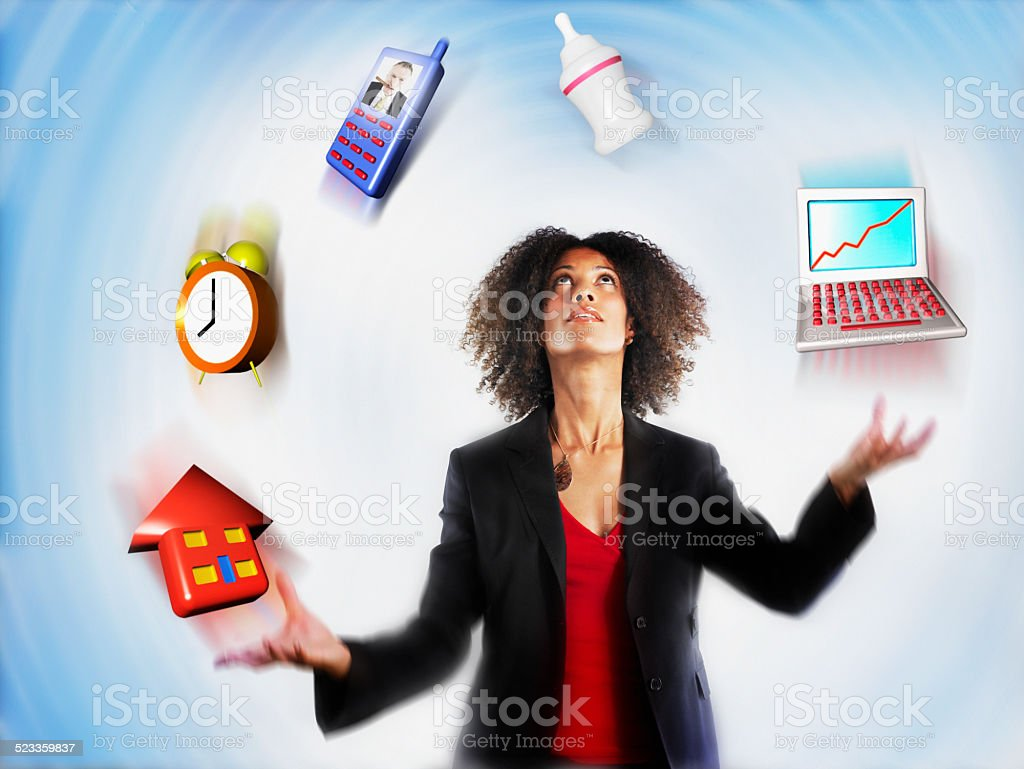 Businesswoman Juggling Responsibility stock photo