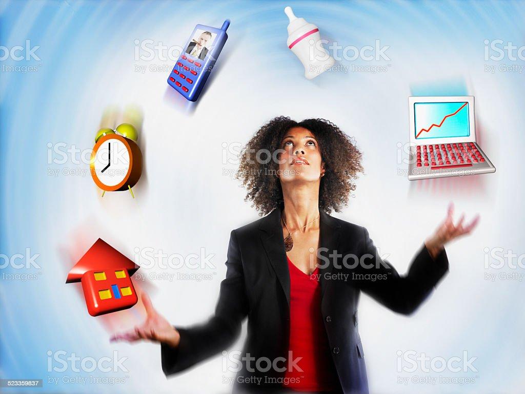 Businesswoman Juggling Responsibility stock photo
