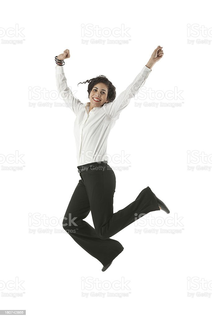Businesswoman jumping for joy royalty-free stock photo