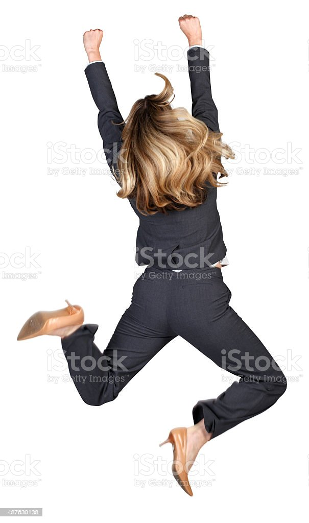 Businesswoman Jumping For Joy stock photo