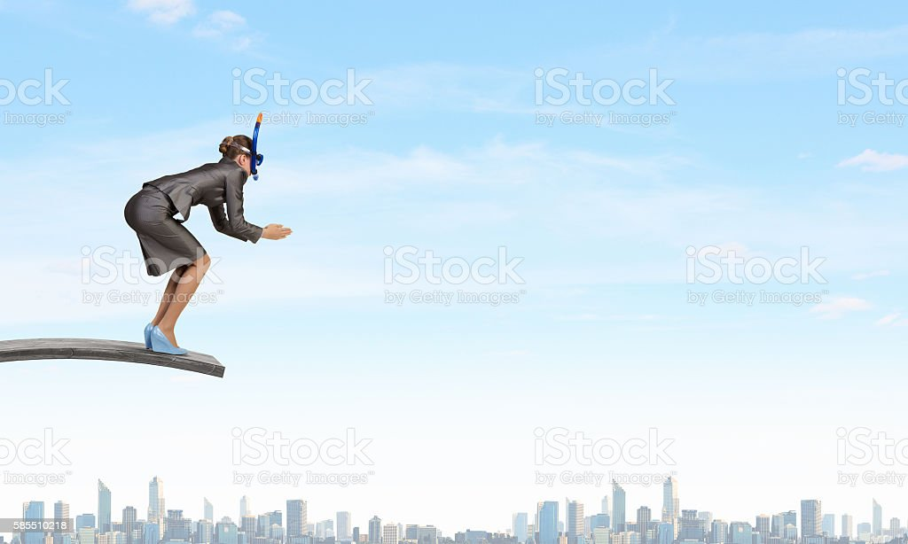 Businesswoman jumping in water . Mixed media stock photo