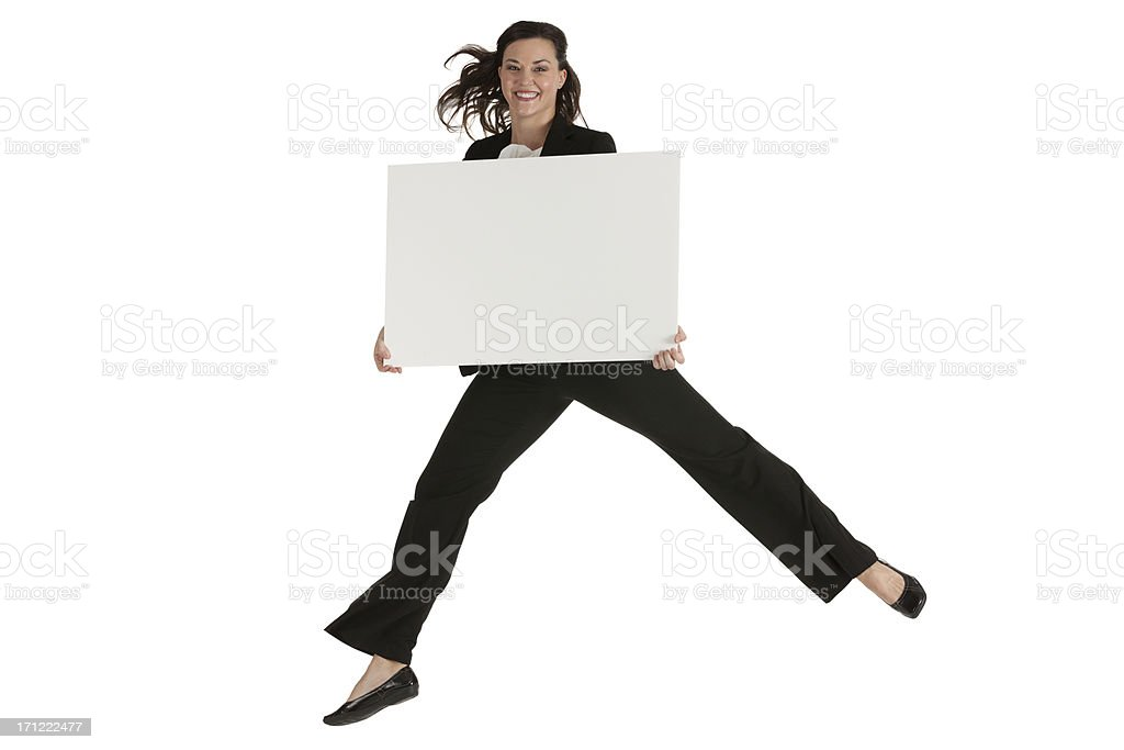 Businesswoman jumping with a placard stock photo