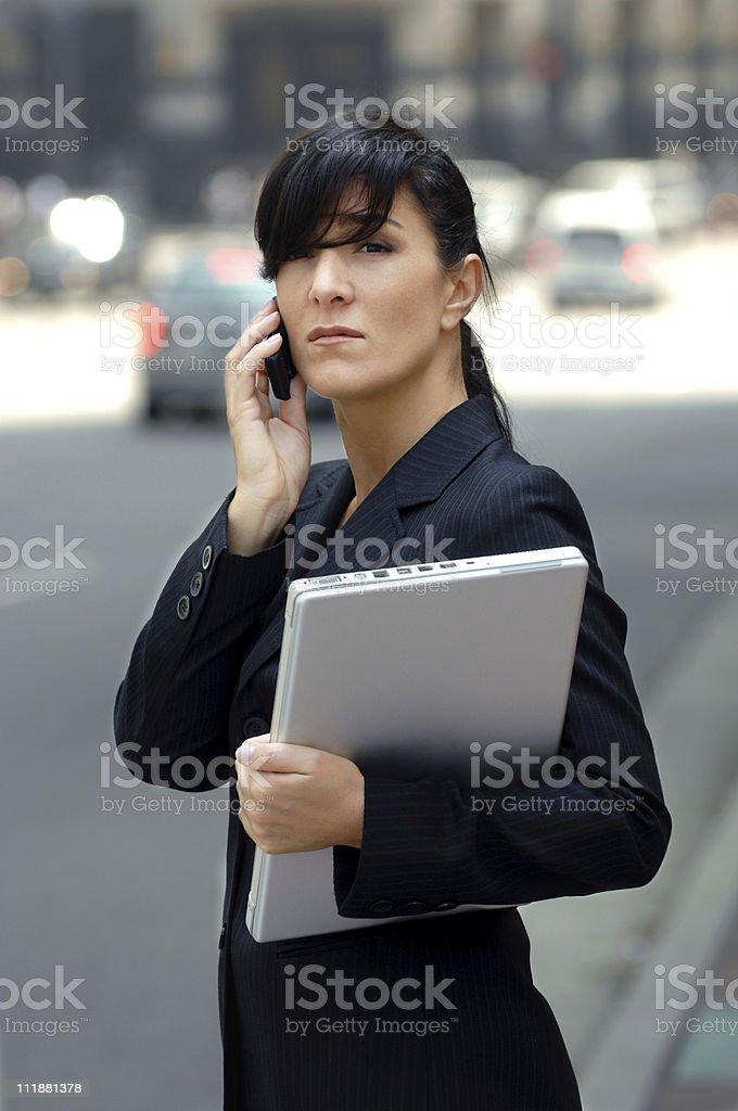 Businesswoman Laptop Computer Talking Cellphone Financial Distric Street royalty-free stock photo