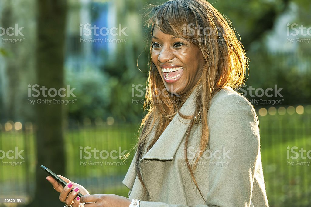 Businesswoman Laughing in Park, London UK stock photo