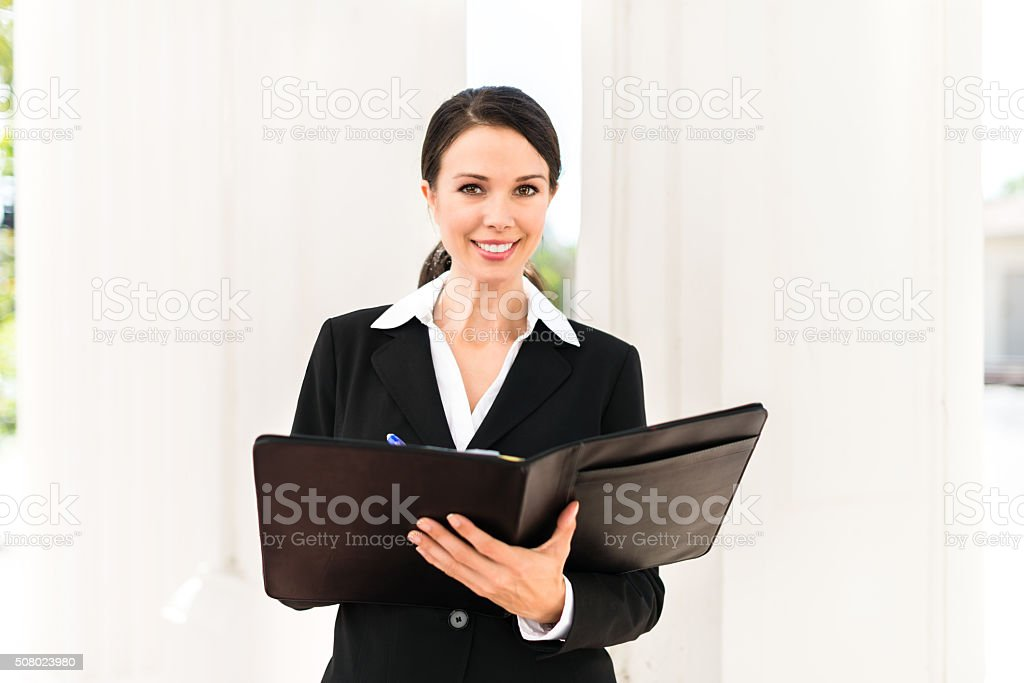 Businesswoman Lawyer Attorney at Courthouse stock photo