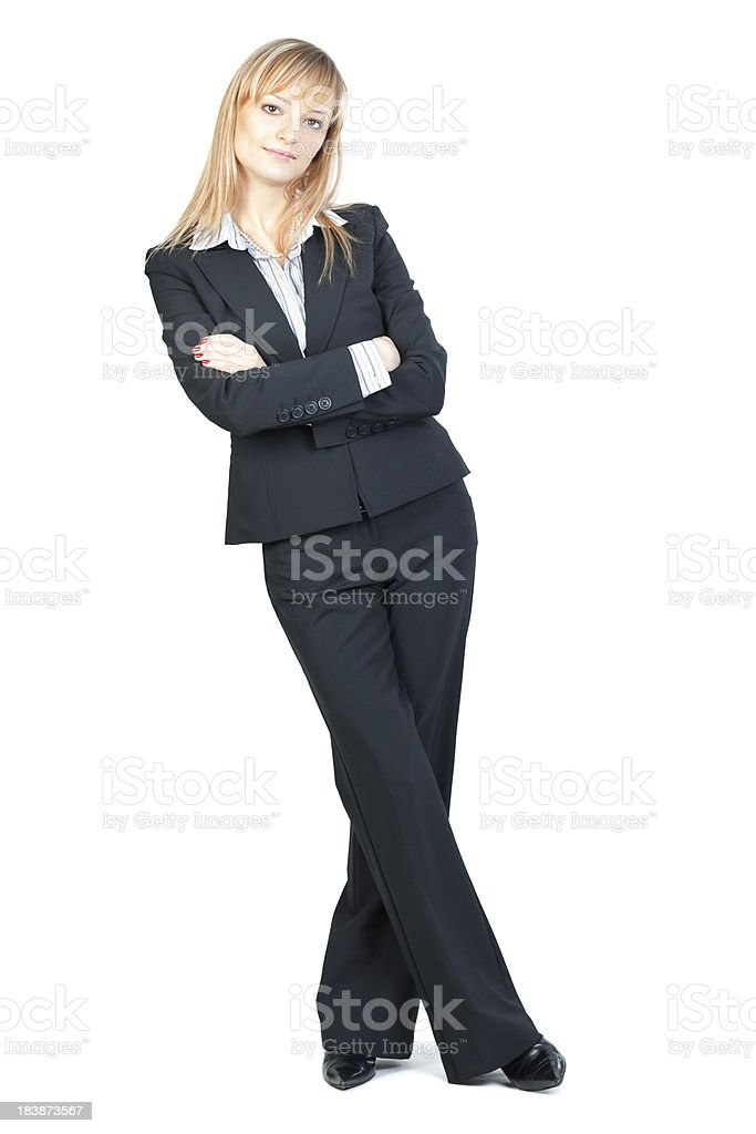 Businesswoman leaning arms crossed royalty-free stock photo