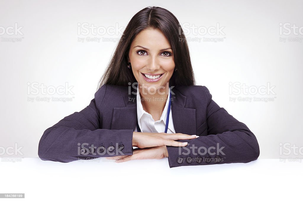 Businesswoman leaning on a white empty banner royalty-free stock photo