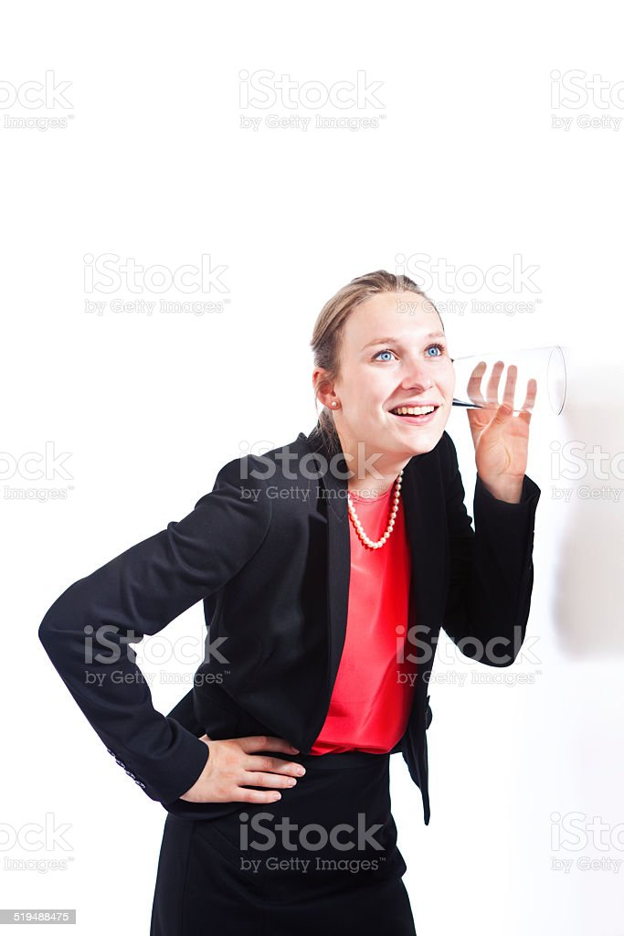 Businesswoman Listening in on Secret and Gossips with Glass stock photo