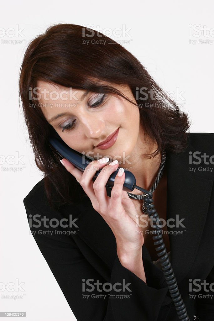 Businesswoman listening to caller on the phone royalty-free stock photo