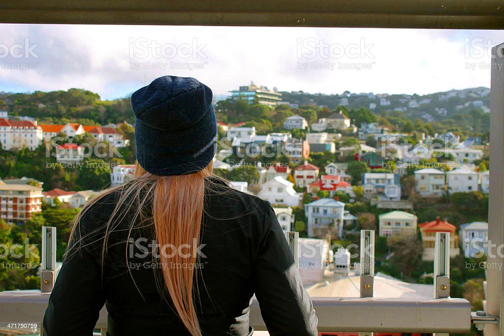 Businesswoman Loking Out From Hotel Room royalty-free stock photo