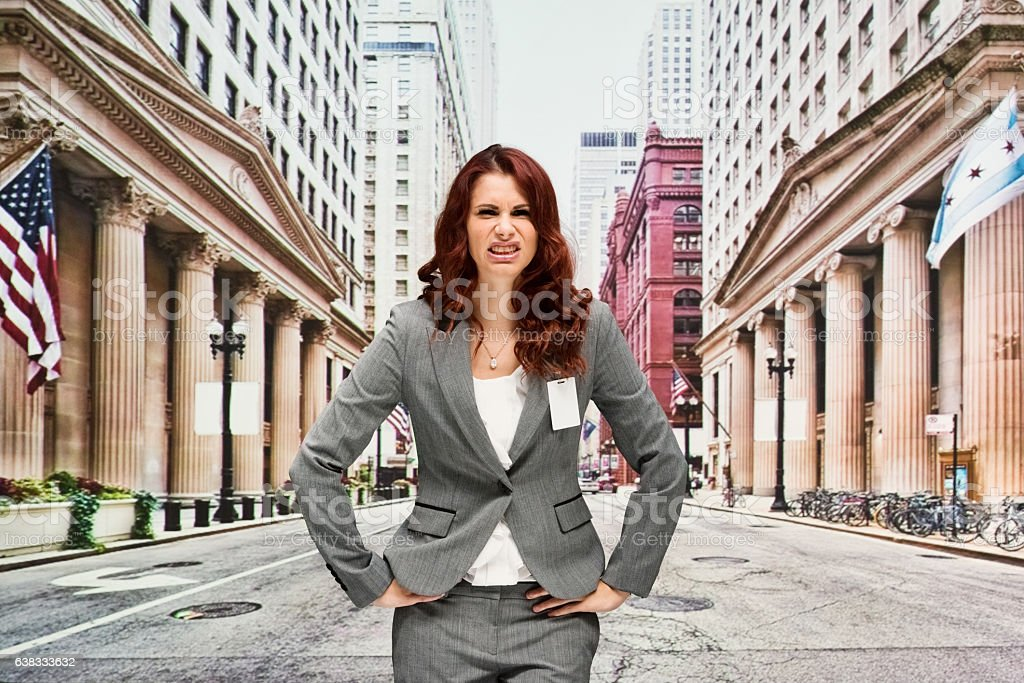 Businesswoman looking angry outdoor stock photo