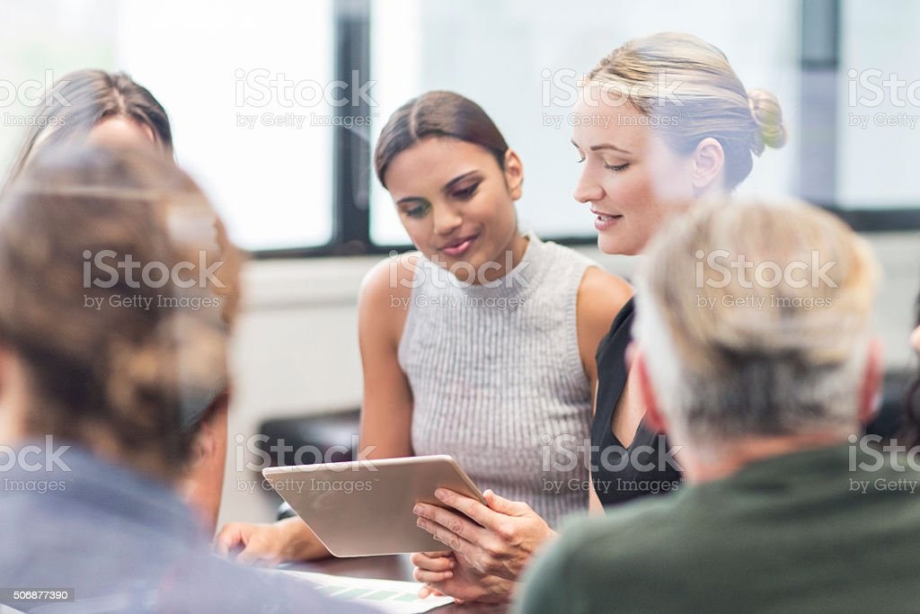 Businesswoman looking at a digital tablet on a meeting stock photo
