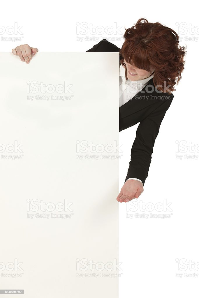 Businesswoman looking at a placard stock photo