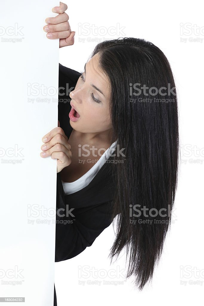 Businesswoman looking at a placard with surprise royalty-free stock photo