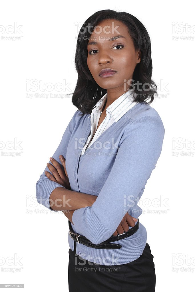 Businesswoman looking at camera with arms crossed royalty-free stock photo