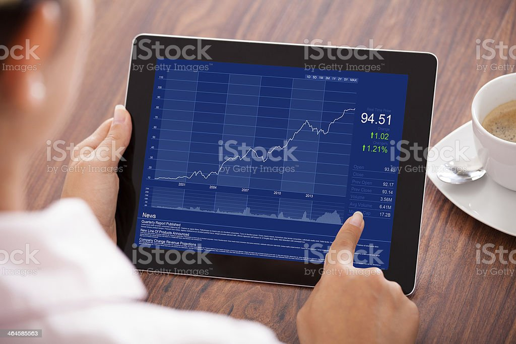 Businesswoman Looking At Graph stock photo