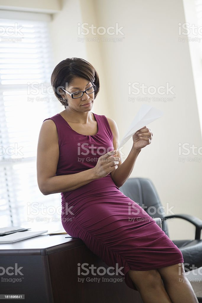Businesswoman Looking At Paper Plane royalty-free stock photo