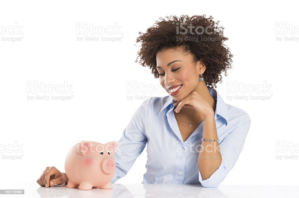 Businesswoman Looking At Piggybank royalty-free stock photo