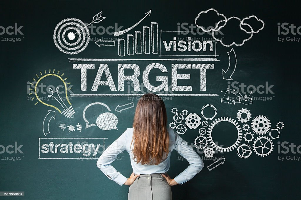 Businesswoman looking at strategy sketch stock photo