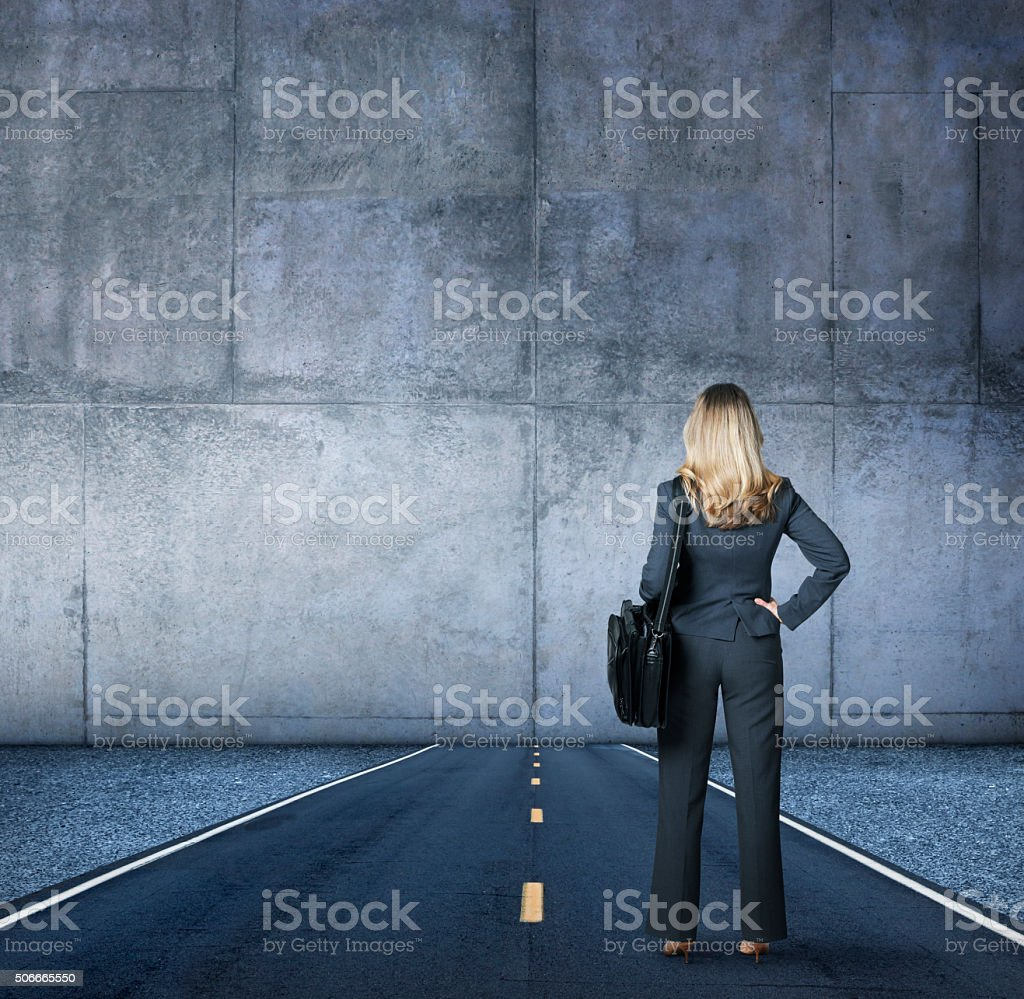 Businesswoman Looking At The End Of The Road stock photo