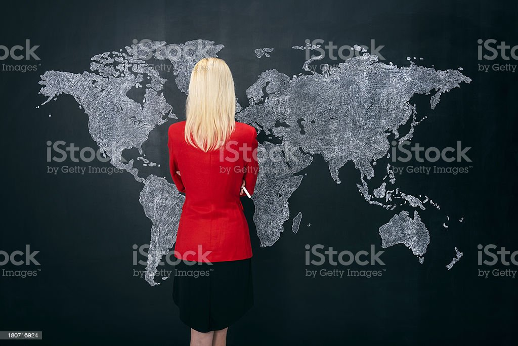 Businesswoman looking at world map royalty-free stock photo