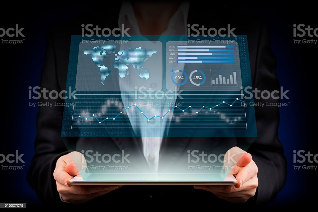 Businesswoman looking financial graphics on tablet computer stock photo
