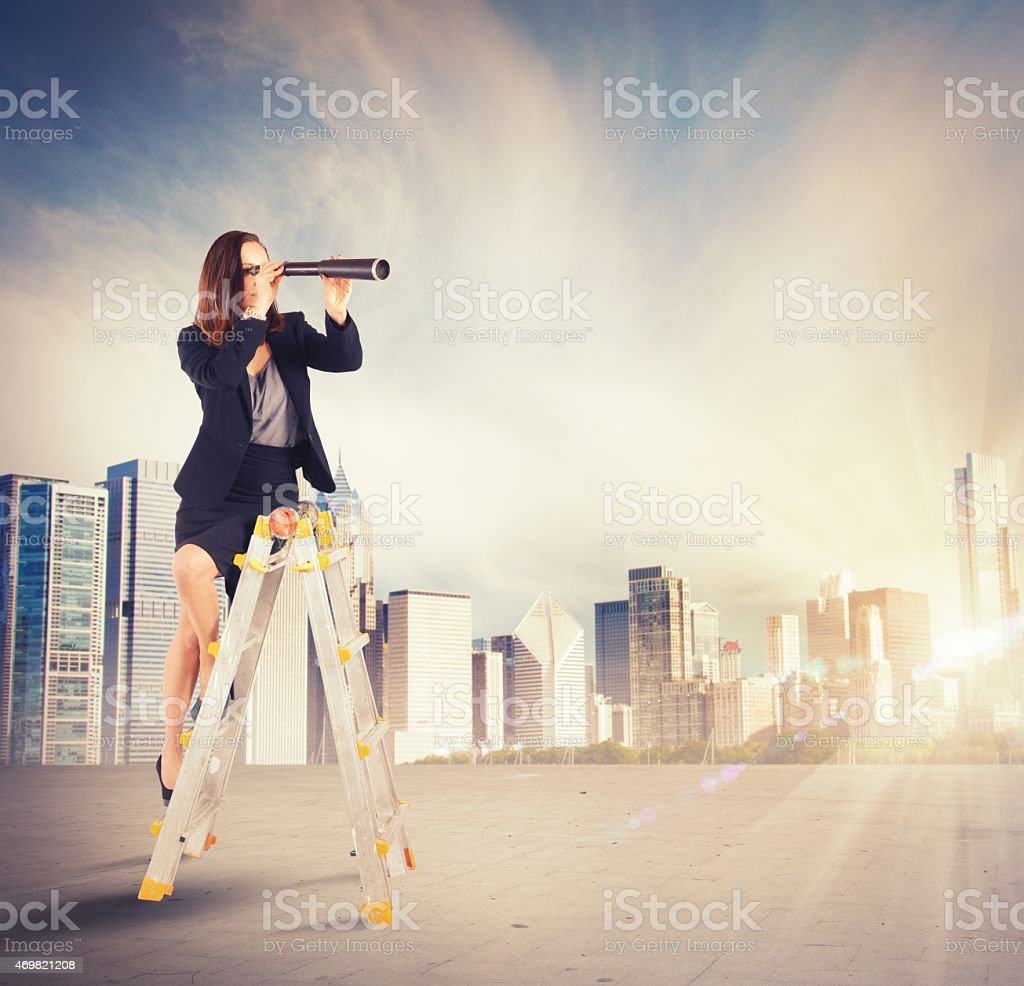 Businesswoman looking for new goals stock photo