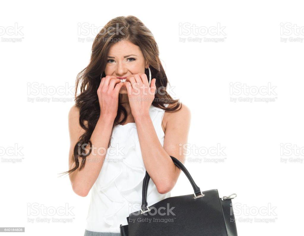 Businesswoman looking nervous stock photo