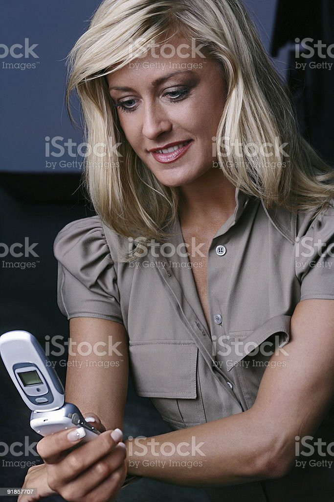 businesswoman looking on her cell phone royalty-free stock photo