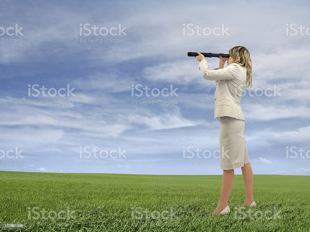 Businesswoman Looking Through a Telescope royalty-free stock photo
