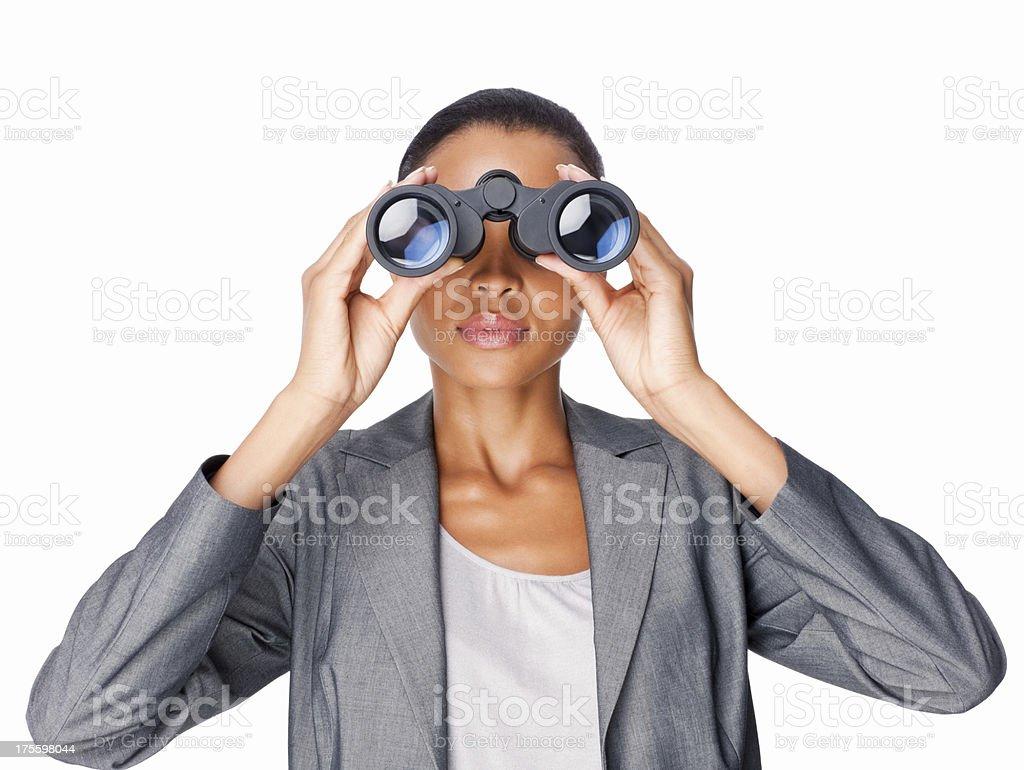 Businesswoman Looking Through Binoculars - Isolated stock photo