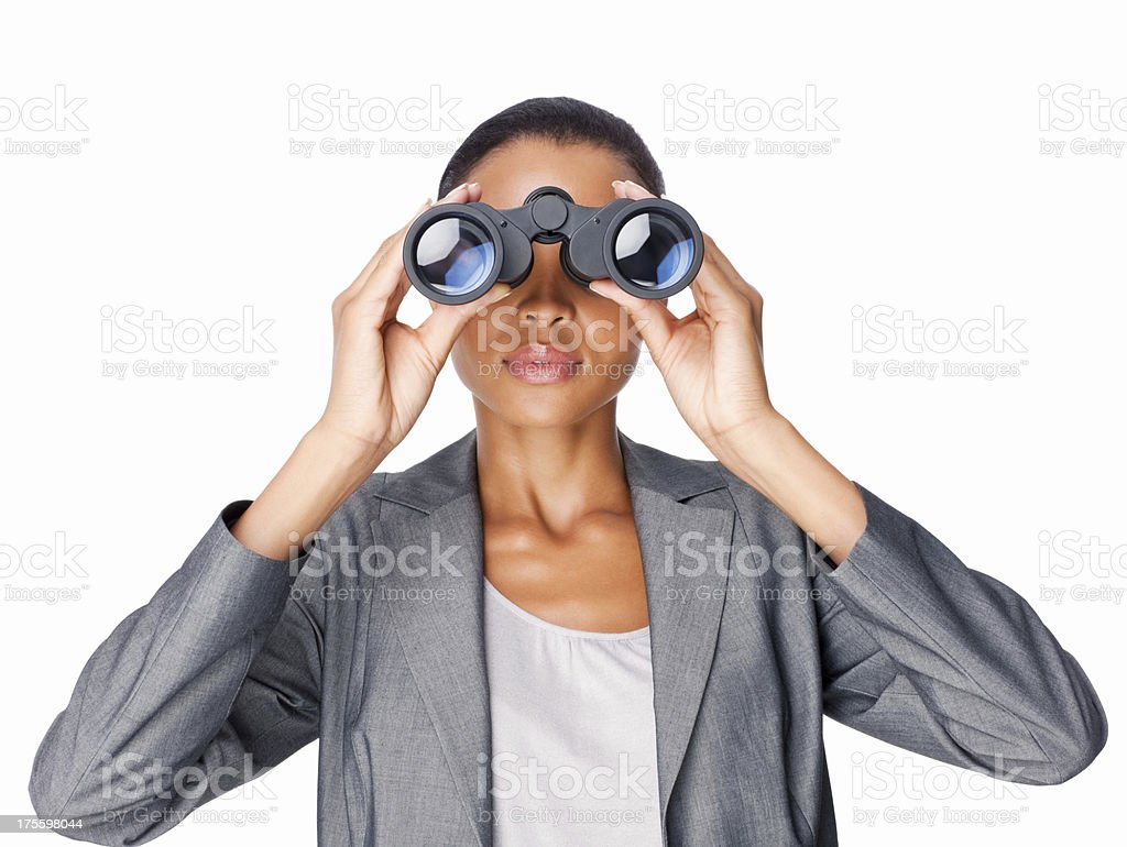 Businesswoman Looking Through Binoculars - Isolated stock photo