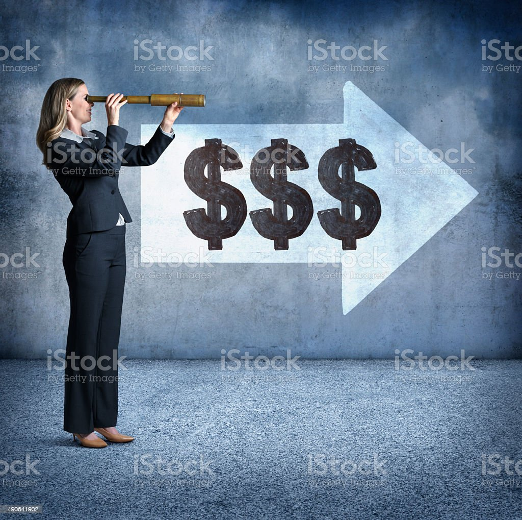 Businesswoman Looking Through Spyglass At Where The Money's Going stock photo