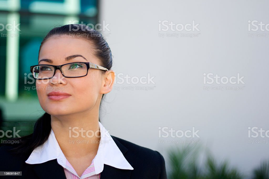 Businesswoman looking up with copy space royalty-free stock photo