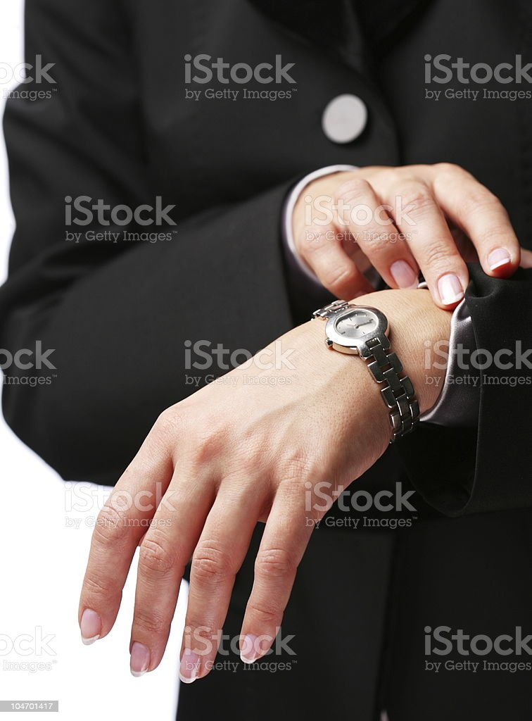 Businesswoman looks at his watch stock photo