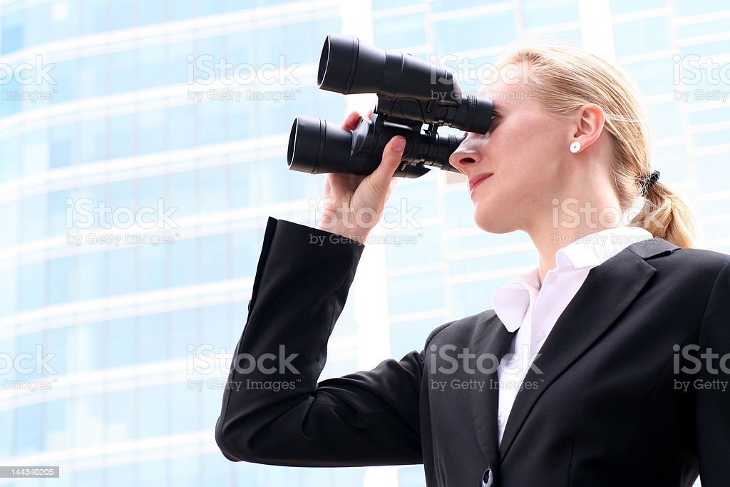Businesswoman looks into the future royalty-free stock photo