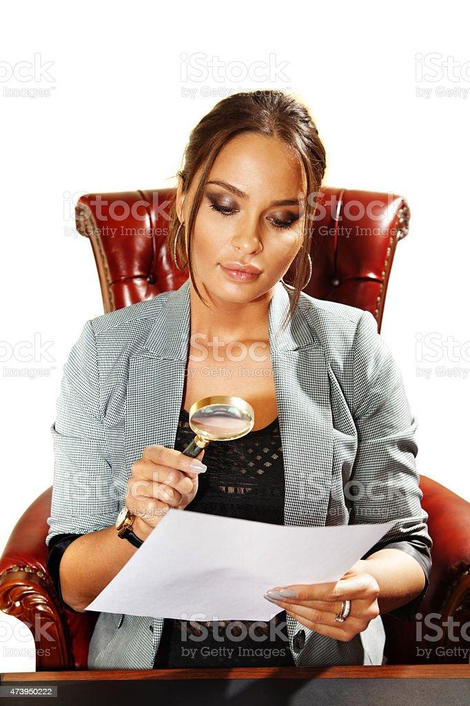 businesswoman looks on document stock photo