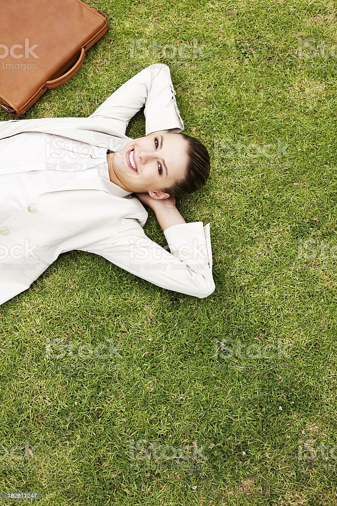 Businesswoman Lying in the Grass royalty-free stock photo