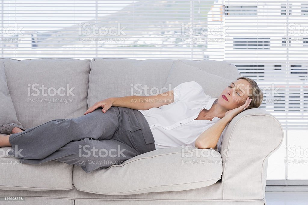 Businesswoman lying on couch royalty-free stock photo