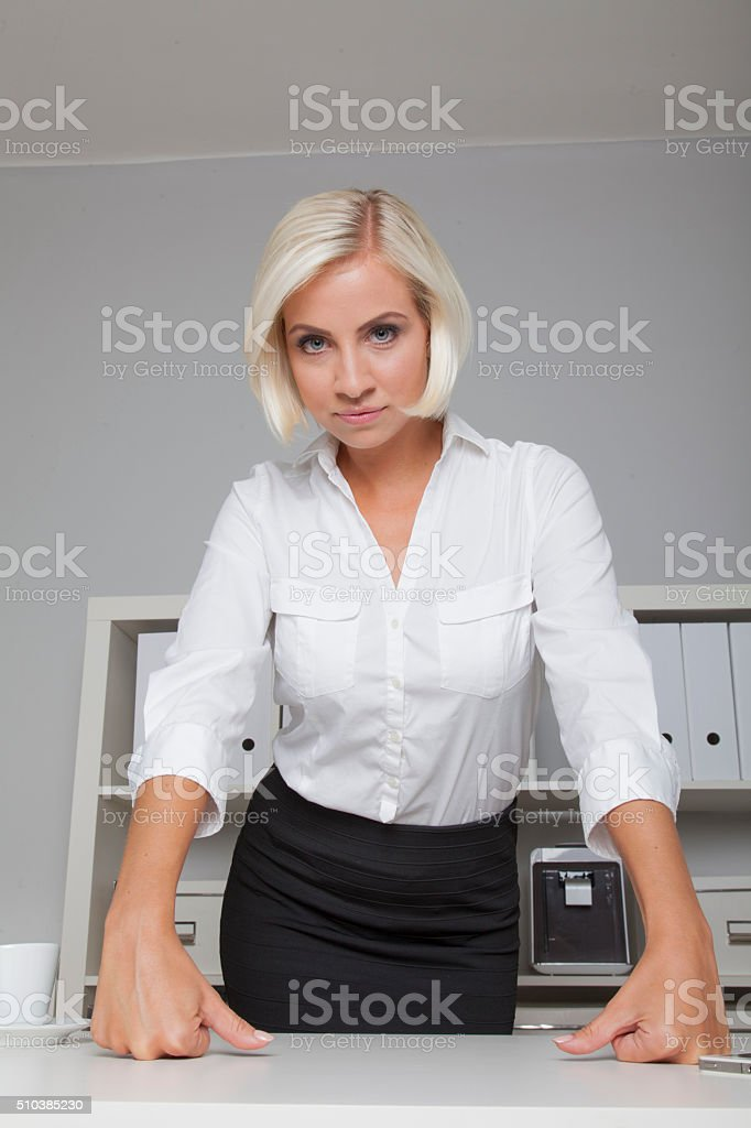 Businesswoman makes a strict strong expression stock photo