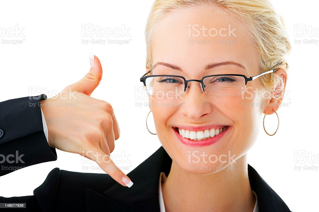 Businesswoman making a call sign against white background royalty-free stock photo