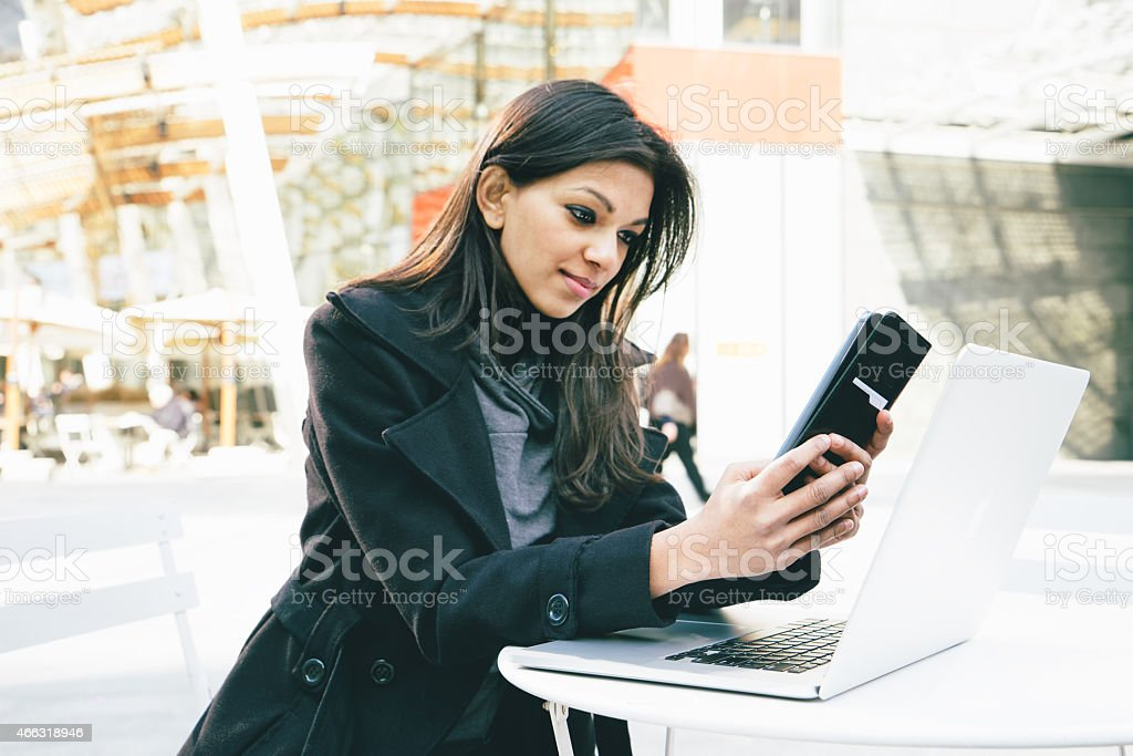Businesswoman Making A Video Call Using Smartphone stock photo
