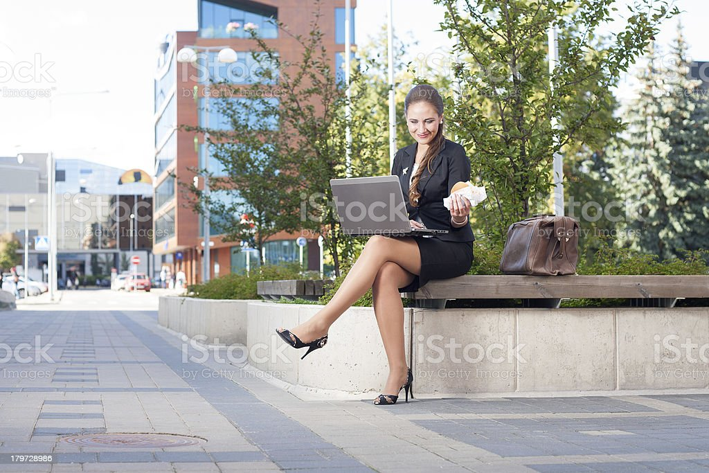 Businesswoman making lunch outdoor in the city royalty-free stock photo