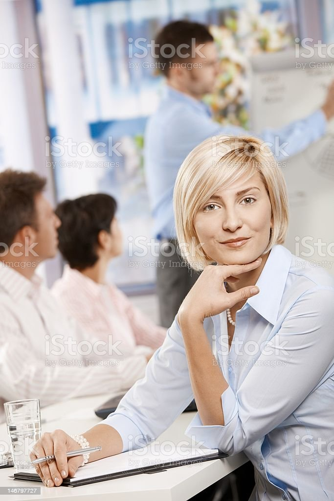 Businesswoman making notes on meeting stock photo