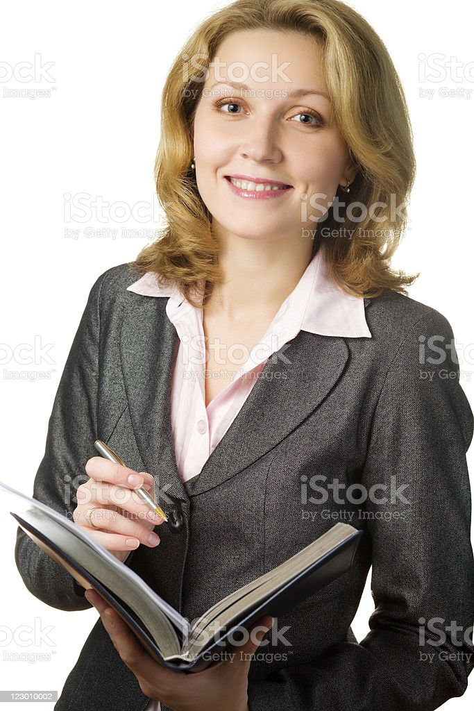 Businesswoman making notes royalty-free stock photo