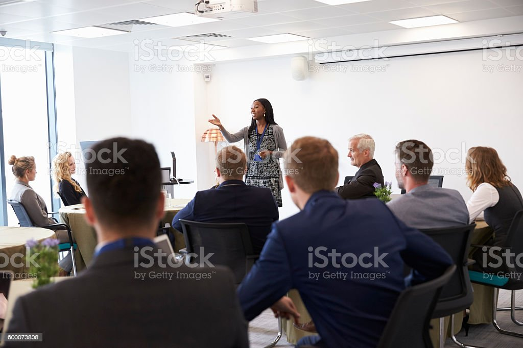 Businesswoman Making Presentation At Conference stock photo